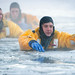 U.S. Air Force fire protection specialists conduct during ice rescue training at Six Mile Lake on JBER