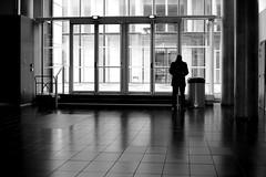In the bright hall (pascalcolin1) Tags: paris13 homme man lumière light hall reflets reflection lumineux bright fenetres windows photoderue streetview urbanarte noiretblanc blackandwhite photopascalcolin 50mm canon50mm canon