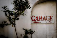 Around the corner (vale0065) Tags: red rood garage door deur poort gate malta island eiland sign teken pijl arrow plant green groen street straat