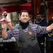 Restaurant owner dancing with an octopus to advertise his delicious food in Palermo on the Italian island of Sicily