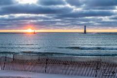 Rare View of Sun (SueFi Photography) Tags: frankfort sunset sunrays beach lakemichigan water sand greatlakes upnorth beautiful