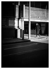 Pass the Parking (Dave Button) Tags: bw street border fuji fujifilm xpro2 35mm photo photography mono monochrome lines chiaroscuro shadow light woman walk walking walker blackandwhite black white grey tones shade sunlight pedestrian pavement carpark lacemarket nottingham