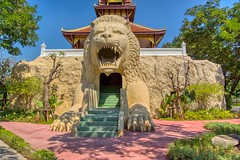Building with a lion's head as entrance in Muang Boran (Ancient City) in Samut Phrakan, Thailand (UweBKK (α 77 on )) Tags: muang mueang boran ancient city siam outdoors park garden open air museum education recreation culture history tradition samut phrakan province bangkok thailand southeast asia sony alpha 77 slt dslr building house architecture lion head entrance door doorway stone