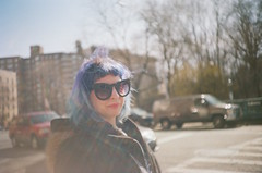Pretty Miss Kitty (Gabriella Ollandini) Tags: girl woman lady beauty pretty sunglasses hair lilac purple 35mm kodak streetphotography brooklyn nyc city urban softfocus haze lightleak istillshootfilm filmphotography filmisnotdead candid portrait humans people analogue analog analogica sunny sunshine 200 color plus vintage camera cat kitty hairstyle young youth glamor glamour chic dyed