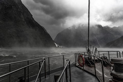 Riders on the Storm  DSC_4759 (BlueberryAsh) Tags: 2019 milfordsound milfordsoundroad newzealand teanau boat storm weather waterfall ocean lake cloudsstormssunsetssunrises mist fog red monochrome mountains south island travel tourism