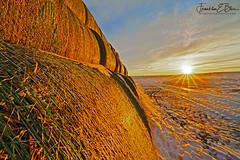 Perspective Hay Bale Sunrise (franklin331) Tags: aspect backcountry bale bliss blissdinosaurranch blissphotographics blissranch border borderlands factfriday followfriday frame frankbliss franklinebliss fridayfun fridayreads haybale haystacksunrise image land landscape montana perspectivehaybalesunrise photo ranchlands roundbale scenery scenic snow sonyalpha sunrise wyoming