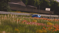 Lamborghini Huracan (at1503) Tags: car blue green yellow pink flowers spain foregroundblur blur lamborghini huracan lamborghinihuracan supercar italiancar gtsport granturismo granturismosport motorsport racing game gaming ps4 track circuit orange warmtones