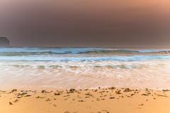 Hazy Summer Seascape (Merrillie) Tags: daybreak smokehaze centralcoast morning nature water sea macmasters dawn earlymorning landscape newsouthwales rocks haze nsw waves coast ocean sunrise waterscape hazy coastal macmastersbeach sky seascape smoky misty outdoors australia