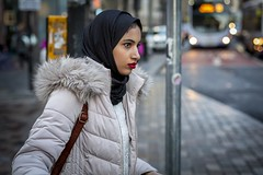 Passing By (Leanne Boulton) Tags: urban street candid portrait profile portraiture streetphotography candidstreetphotography streetportrait candidportrait streetlife woman female girl pretty face eyes expression mood emotion feeling makeup lipstick red hijab fur hood cold winter traffic tone texture detail depthoffield bokeh naturallight outdoor light shade city scene human life living humanity society culture lifestyle people canon canon5dmkiii 50mm primelens ef50mmf14usm colour glasgow scotland uk