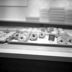pastry dreams (kaumpphoto) Tags: rolleiflex 120 tlr ilford hp5 bw black white store retail shop pastry donut selection bake display sweet delicious tasty breakfast food