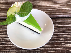 A slice of cheese-cake with lemon flavor and whipped cream on a white plate and wooden table background. (baddoguy) Tags: backgrounds bakery brown cafe cake cheesecake citrus fruit closeup color image copy space decoration dessert topping directly above elegance flowing food drink freshness gourmet green group of objects harmony healthy eating homemade horizontal leaf lemon liquid mint culinary no people nutritional supplement organic pattern photography plate readytoeat refreshment slice snack sour taste sunlight sweet table textured thailand whipped cream white wood material