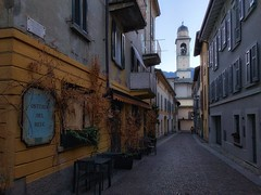 Street walking, Cernobbio (mswan777) Tags: city street urban building architecture outdoor walk morning store sign apple iphone iphoneography mobile cernobbio italy cityscape stone tower window shutter