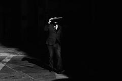 Saliendo A La Luz (natan_salinas) Tags: streetphotography fotografíaurbana fotografíacallejera bw blackwhite blanconegro bn blancoynegro blackandwhite monocromático monochrome nikon gente portrait retrato d5100 street calle urbe urban urbano 50mm cara face rostro streetportrait retratocallejero retratourbano people noiretblanc valparaíso valpo city ciudad luz light shadow sombras chile miradas look mirada man male hombre