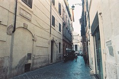 Roma (goodfella2459) Tags: nikonf4 afnikkor24mmf28dlens adoxcolorimplosion100 35mm c41 film analog colour streets italy building roma road rome buildings manilovefilm