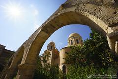 Agia Triada Monastery (right2roam) Tags: greece crete mediterranean island sunny agiatriada monastery warm garden starburst right2roam architecture architectural orthodox christianity arch arches stone