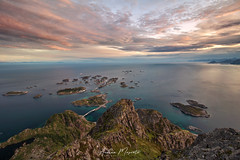 Henningsvaer - Lofoten Islands (Norway) (Andrea Moscato) Tags: andreamoscato norvegia norge bokmål nynorsk north europe view vivid vista day light luce shadow ombre blue white red yellow cielo sky water sea reflection riflesso art artist clouds nature natura nuvole natural naturale fiordo fiord mountain montagna mare landscape deep path trail trekking hiking history historic panorama monument tourist attraction scogliera cliff rock stones air overlook fishing village city città cityscape island sun sunset dusk tramonto orange road street top evening