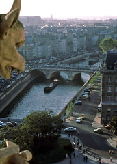 The Seine flowing through Paris, from Notre-Dame, 1978 (D70) Tags: seine flowing paris notredame 1978 river îledefrance france buildings film scanned slide kodachrome 64 halfframe fzuiko autos 38mm f18 olympus penf