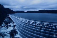 The blue hour at the dam. (brianloganphoto) Tags: stone waterfalls sunrise historic newyorkcitywatersupplysystem water westchester newyork outdoor spillwater newcrotondam cornelldam historical attraction newcrotonreservoir travel sky westchestercounty gorge alphonsefteley spillway famous waterfall infrastructure landscape flowing day nature landmark stream masonrydam falls splash croton view crotonriver dam morning cortlandt blur scenery wroughtironlatticetower architecture motion winter history outdoors overflow old tourism intrastructure reservoir