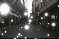 Bologna (Snovlox) (goodfella2459) Tags: nikonf4 afnikkor24mmf28dlens revologsnovlox100 35mm blackandwhite film analog city bologna italy streets buildings bwfp