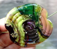 Floriane (Laura Blanck Openstudio) Tags: openstudio openstudiobeads handmade lampwork glass murano beads single focal bead big holes huge flat shiny bold fine art arts artist artisan made usa jewelry necklace pendant boutique abstract asymmetric earthy organic nugget rock pebble stone choker boho bohemian urchin flower swirl lucky charm raku lime green pea frit gray peach rose orange coral yellow ocher transparent violet plum grape purple eggplant red forest jungle blue black parrot chartreuse grass