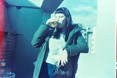 the birthday girl / on film (aldanakotler) Tags: aire cielo balcon fujifilm fuji 400 200 800 lomography lomo nikon canon k1000 pentax kodak film girl cumpleañera cumpleaños birra beer cerveza fotografia foto analogicas analogica analogue