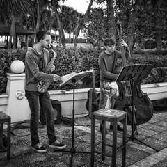 Music at the park (Jack Blackstone (OnTheRoad...Off/On)) Tags: candid hyperfocaldistancemanualfocus flickrfriday yourculture fundraiser environmentalportraits ontheroad musicians ipadedit snapseed verobeach music streets monochrome blackandwhite leicaq2