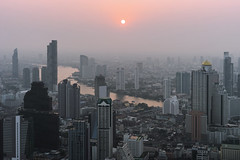 Smoggy Bangkok Sunset (Kokkai Ng) Tags: smoggy bangkok sunset smog dusk pollution smokey smoke haze thailand chao phraya river skyscrape cityscape skyline