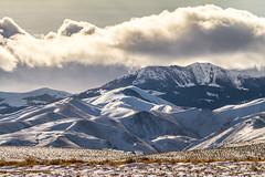 Wind Blown Slopes (JGemplerPhotography) Tags: snow owyheemountains mountains cloudsstormssunsetssunrises clouds plains