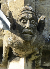 Grotesque on St Peter's Church, Winchcombe, Gloucestershire, England (alexdavidwriter) Tags: winchcombe gloucestershire england britain europe church medieval gargoyle grotesque sculpture statue face stone stpeterschurch english