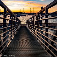 Ramp to the Dock 2 (lorinleecary) Tags: lines dock sunset clouds water morrobay rust tidelandspark boats sky ramp metal