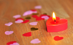 Loveheart candle (Martyn.Hayes) Tags: candle flame love heart loveheart romance valentines valentinesday confetti wood red pink gold