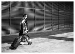 Canary Couple (Dave Button) Tags: london canarywharf street light shadow people blackandwhite bw woman man monochrome walking mono shadows border tourists walker xe2s city urban lines pavement diagonal