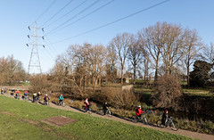 Saturday outing (Francis Mansell) Tags: people bicycle cyclist pylon powerline tree walthamstowwetlands grass bank london leavalley