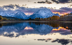 Mount Moran view from Oxbow Bend beside Snake River of Grand Teton, Wyoming. (jack-sooksan) Tags: oxbowbend mount mountain moran grandteton snakeriver river pond lake reflection forest jungle wild wood woods sunset twilight sunrise dawn dusk sky landscape panorama snow winter autumn climate cold weather tree water surface horizon america unitedstates usa national park reflect natural skyline scenic mountains beautiful range scenery nature cloudy