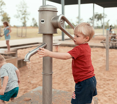Pumping water (VirtualWolf) Tags: australia bokeh bungarribee bungarribeepark canonef35mmf14liiusm canoneos5dmarkiv newsouthwales people sydney toddler
