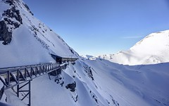 Into a tunnel, over a bridge, and into a tunnel (PeterThoeny) Tags: lenzerheide parpan vazobervaz arosa switzerland grison graubünden alps swissalps parpanerrothorn rothorn sun ski skiing skiresort slope skislope tunnel bridge mountain day clear snow winter outdoor sony sonya6000 a6000 selp1650 3xp raw photomatix hdr qualityhdr qualityhdrphotography fav100