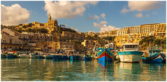 Colourful Harbour. (Ian Emerson (Thanks for all the comments and faves) Tags: mgarr gozo fishingboats boats harbour mediterranean church sunlight sea architecture canon6d canon outdoor tourism winter january sunny picturesque omot