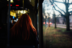 You say you want a revolution (ewitsoe) Tags: buses mpk nikon poznan street trams winter erikwitsoe womna redhair window tram seated lady female ginger reflection morning bokeh riding sitting travel transit commute commuter