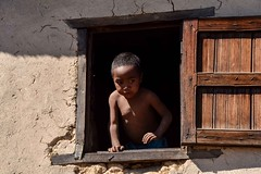 Malagasy Boy (Rod Waddington) Tags: africa african afrique afrika madagascar malagasy boy child culture cultural candid window shutters house village portrait outdoor