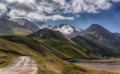 The Pamir Highway (Wim van de Meerendonk, loving nature) Tags: kirghistan mountain mountainscape mountains snow blue color colors colours colour journey centralasia landscape mountainside nature outdoors outdoor panorama rock rocks sony sky scenic cloud contrast hill hills valley pamirhighway clouds cloudscape glacier icefield ice light wimvandem