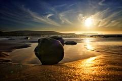An evening stroll (evansmark425) Tags: beach sunset rock pebbles seascape whitefordbeach wales uk
