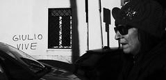 Giulio lives!! (Baz 120) Tags: candid candidstreet candidportrait city contrast street streetphoto streetcandid streetportrait strangers rome roma ricohgrii europe women monochrome monotone mono noiretblanc bw blackandwhite urban life portrait people provoke italy italia grittystreetphotography faces decisivemoment
