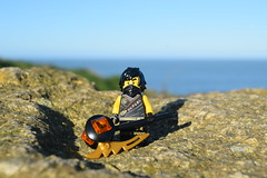 Character Scene: - Cole. (Working hard for high quality and good work.) Tags: legacy ninjago lego character toy sunny day rock seaside blue sky minifigure earth