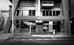 Bus stop (Missing Pictures) Tags: austria vein busstop stop roud street streetphoto streetphotography architecture architectural residence monochrome mood explore europe eu explored emptystreet urban town travel traveling black bw blackandwhite contrast construction passage windows experimental experimentalarchitecture