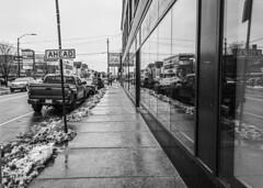 (jfre81) Tags: chicago avondale logan square boundary neighborhood commercial strip street sidewalk black white blackandwhite bw monochrome cars parked window reflection store winter snow 312 landscape cityscape streetscape windy second city urban james fremont photography jfre81 canon rebel xs eos