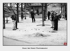 A game of petangue in the gardens of Les Halles, Paris (Hans ter Horst Photography) Tags: 2009 france paris hansterhorst hoshisato believeinfilm ishootfilm filmphotography pentax mz3 pentaxmz3 パリ 白黒 bw blackwhite blackandwhite noireetblanc monochrome zwartwitfotografie monochroom grayscale