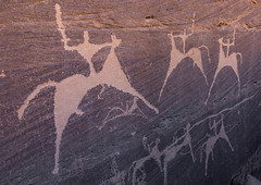 Petroglyphs on a rock depicting men hunting on horses, Najran Province, Minshaf, Saudi Arabia (Eric Lafforgue) Tags: ancient ancientcivilisation arabia archaeology art bi'rhima birhima colorpicture cultures day desert emptyquarter engraving famousplace heritage horizontal horse humanrepresentation hunt hunter incenseroute indigenousculture ksa ksa190871 middleeast minshaf nopeople nonurbanscene outdoors petroglyph petroglyphs photography prehistoricrockart preserves rock rockobject rockart rockcarving rubalkhali saudiarabia stoneobject storytelling thar tourism travel traveldestinations najranprovince