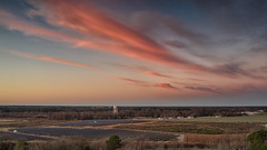 Pink Clouds - 011720-071311 (Glenn Anderson.) Tags: aerial trees partlycloudy earlymorning mavic2pro sunrise clouds cloudsstormssunrisessunsets sky landscape pastels solarreflection morning chanceofrain watertower powerplant solarfarm