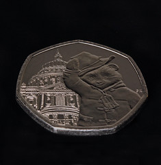 50p Coin (1selecta) Tags: stpaulscathedral coin money metal nickle cash 50 50p 50pence fifty pence bear clothes clothing building background hat coat tag lost eyes eye ear ears hand paw toggle hood padingtonbear