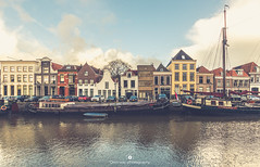 Exploring Zwolle (www.ownwayphotography.com) Tags: river transportation boat water quay netherlands old holland thorbeckegracht zwolle barge canal dutch ship city colorful blue panorama hanseatic transport history center historic sky architecture landmark cityscape building monument historical
